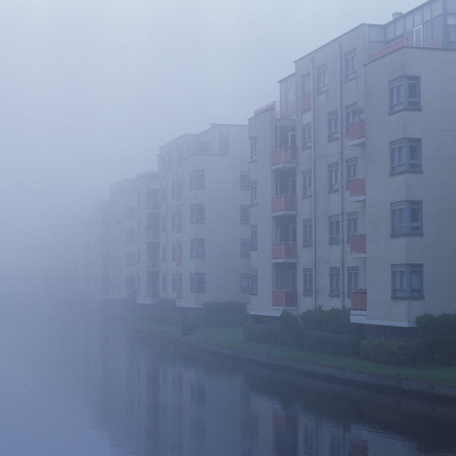 Foggy morning and blocks along a channel